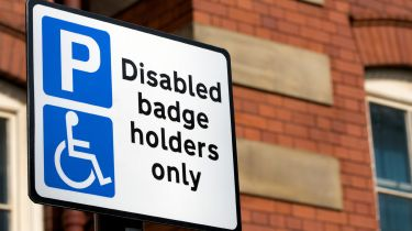 Disabled badge holder parking sign