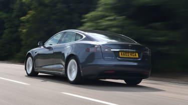 Tesla Model S driving rear