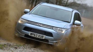 Mitsubishi Outlander PHEV driving through mud