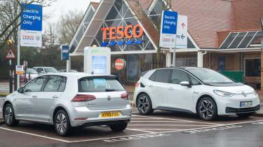Electric VW ID3 car charging outside of Tesco, Potters bar, 24th November 2019
